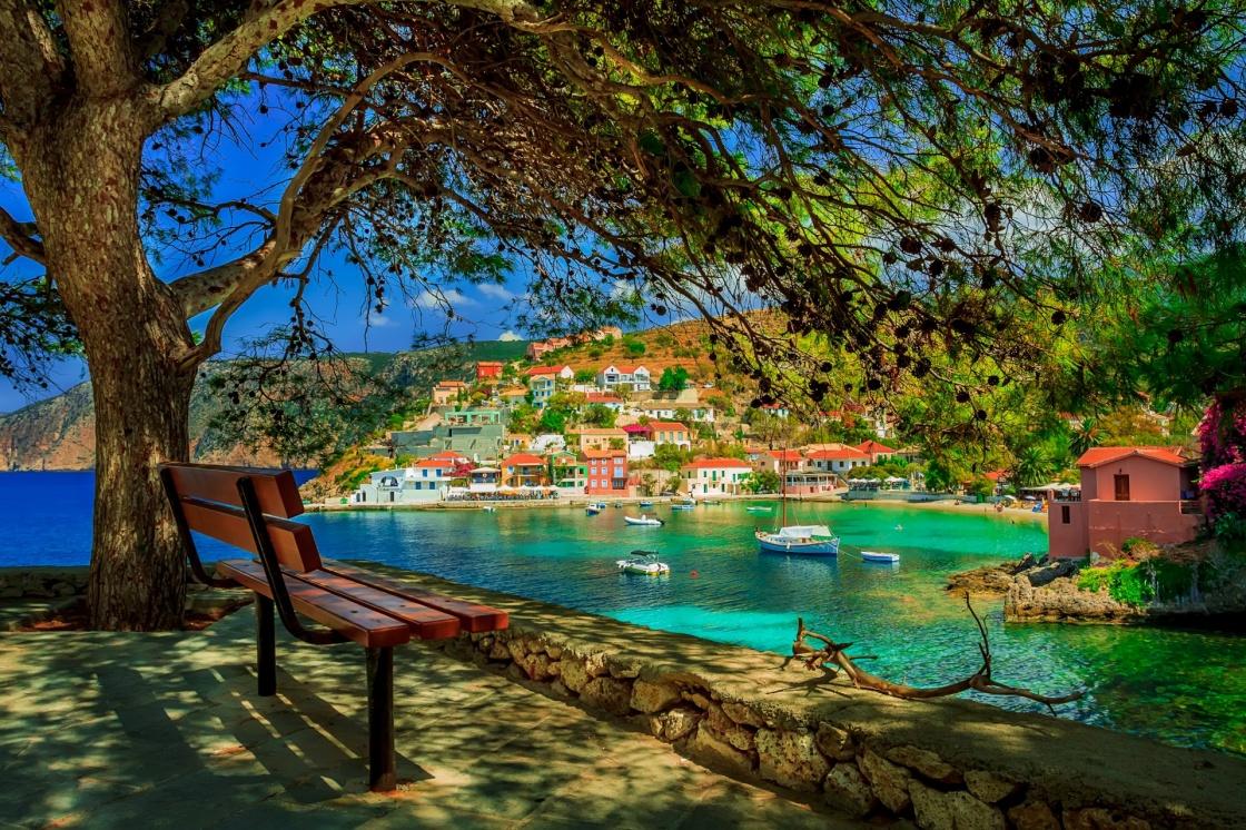ajiotheata-ths-kefalonias-bench-under-a-tree-on-a-sunny-day-at-assos-beach-kefalonia-greece-162-3024
